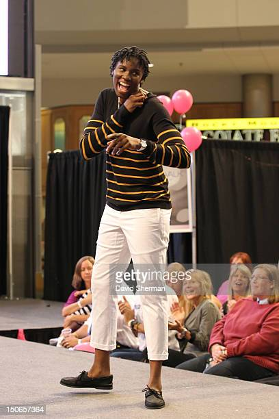 Amber Harris of the Minnesota Lynx walks the runway during the Catwalk for a Cure fashion show fundraiser put on by the Minnesota Lynx players and...