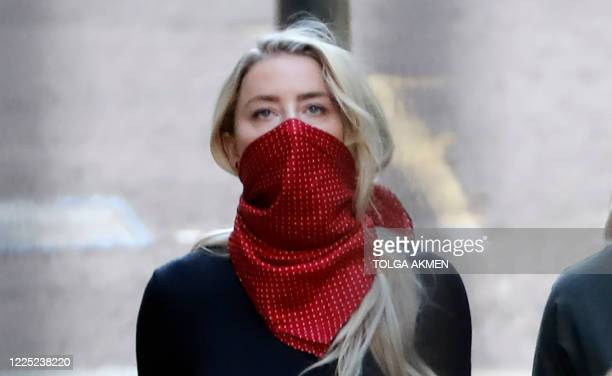 Amber Heard American actress and former wife of Hollywood actor Johnny Depp arrives on the first day of libel trial brought by Hollywood actor Johnny...