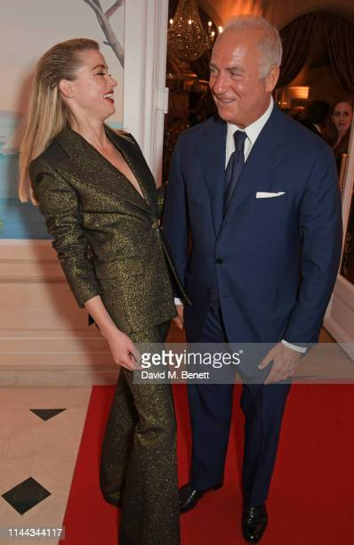 Amber Heard and CEO of Finch Partners Charles Finch attend the 10th Annual Filmmakers Dinner hosted by Charles Finch Edward Enninful and Michael Kors...