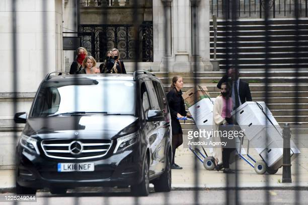 Amber Heard and her team depart after attending day one of Johnny Depp's libel case against the Sun Newspaper at the Royal Courts of Justice Strand...