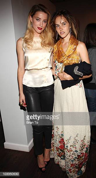 Amber Heard and Isabel Lucas attend photographer Tasya Van Ree's new exhibition Untitled Project opening at the Celebrity Vault on August 11 2010 in...