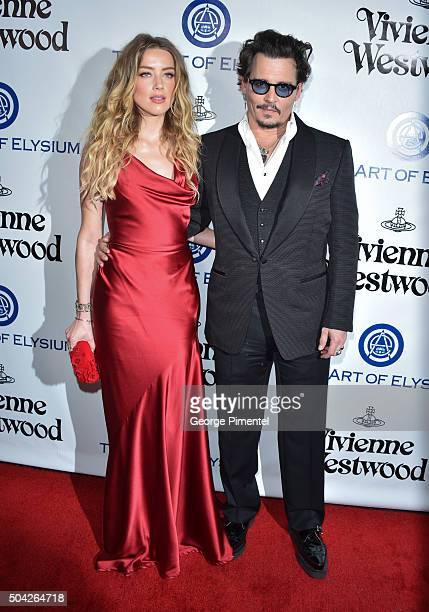 Amber Heard and Johnny Depp attend the Art of Elysium 2016 HEAVEN Gala presented by Vivienne Westwood & Andreas Kronthaler at 3LABS on January 9,...