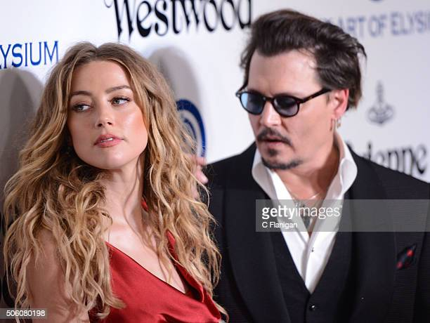 Amber Heard and Johnny Depp attend the Art of Elysium 2016 HEAVEN Gala presented by Vivienne Westwood Andreas Kronthaler at 3LABS on January 9 2016...