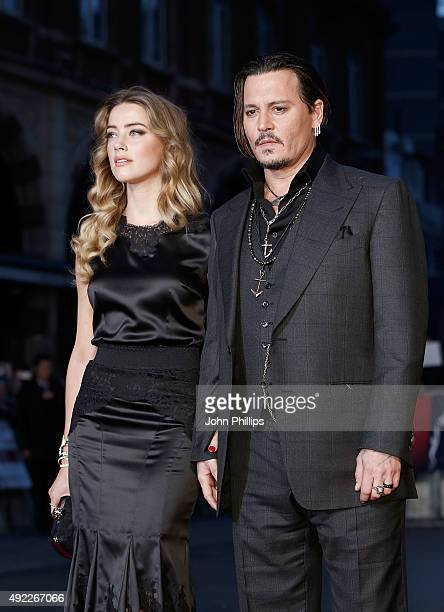 Amber Heard and Johnny Depp attend the Black Mass Virgin Atlantic Gala screening during the BFI London Film Festival at Odeon Leicester Square on...