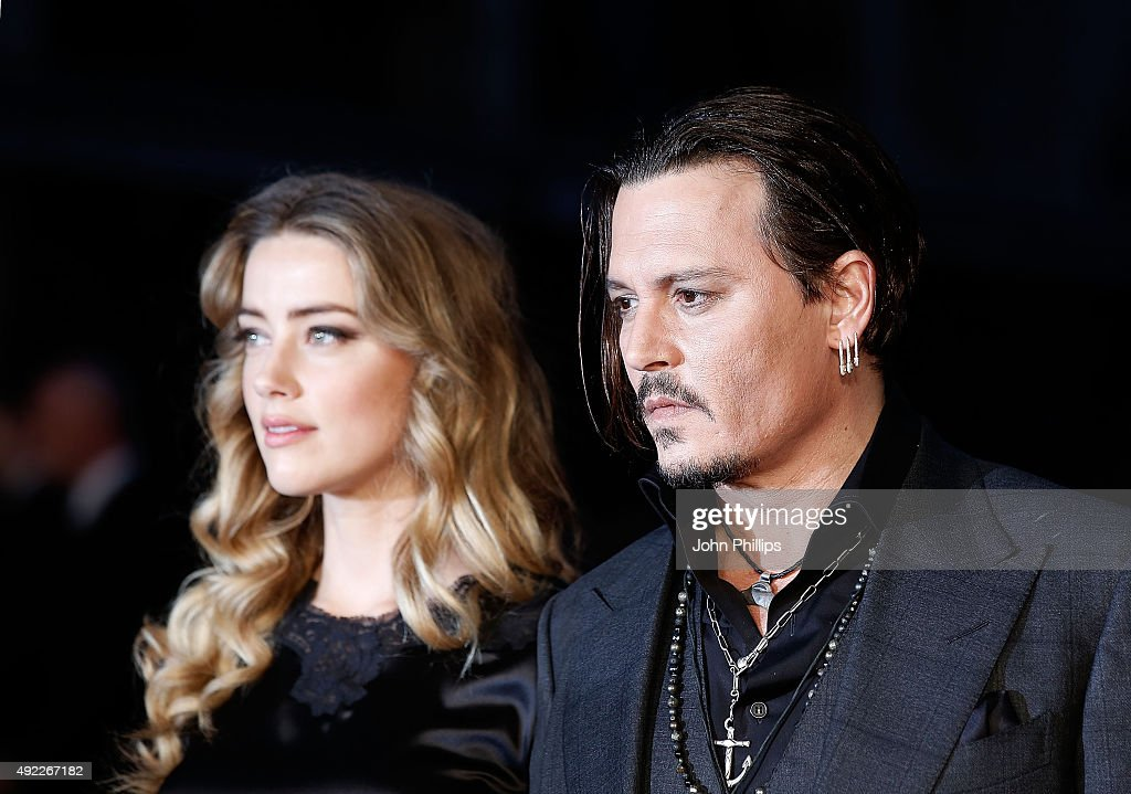 Amber Heard and Johnny Depp attend the 'Black Mass' Virgin Atlantic Gala screening during the BFI London Film Festival, at Odeon Leicester Square on October 11, 2015 in London, England.
