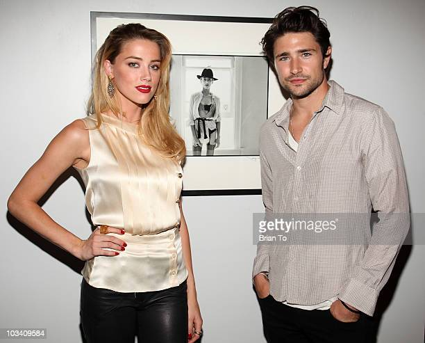 "Amber Heard and Matt Dallas attend photographer Tasya Van Ree's new exhibition ""Untitled Project"" opening at the Celebrity Vault on August 11, 2010..."