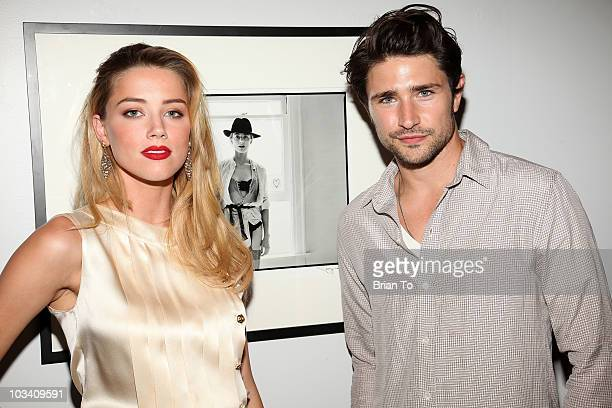Amber Heard and Matt Dallas attend photographer Tasya Van Ree's new exhibition Untitled Project opening at the Celebrity Vault on August 11 2010 in...