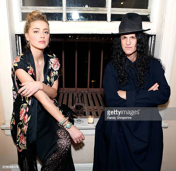 Amber Heard and photographer Amanda Demme attend the Art of Elysium presents Tom Franco at the art salon on May 7 2016 in Los Angeles California