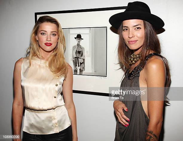 Amber Heard and Tasya Van Ree attend photographer Tasya Van Ree's new exhibition Untitled Project opening at the Celebrity Vault on August 11 2010 in...