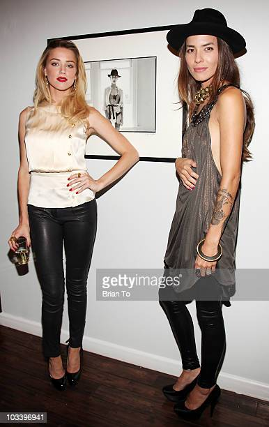 "Amber Heard and Tasya Van Ree attend photographer Tasya Van Ree's new exhibition ""Untitled Project"" opening at the Celebrity Vault on August 11, 2010..."