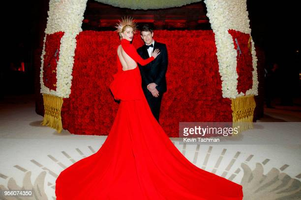 Amber Heard and Wes Gordon attend the Heavenly Bodies Fashion The Catholic Imagination Costume Institute Gala at The Metropolitan Museum of Art on...
