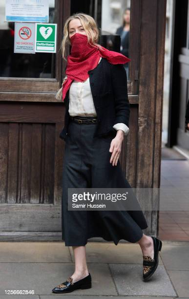 Amber Heard arrives at Royal Courts of Justice, Strand on July 17, 2020 in London, England. American actor Johnny Depp is taking News Group...