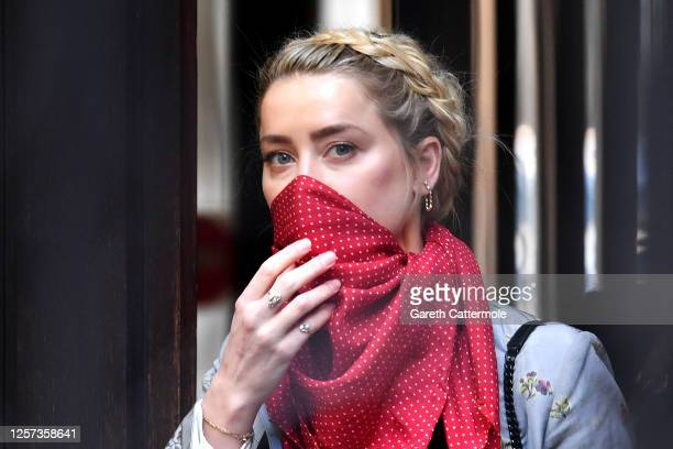 Amber Heard arrives at Royal Courts of Justice, Strand on July 21, 2020 in London, England. The Hollywood Actor is suing News Group Newspapers and...