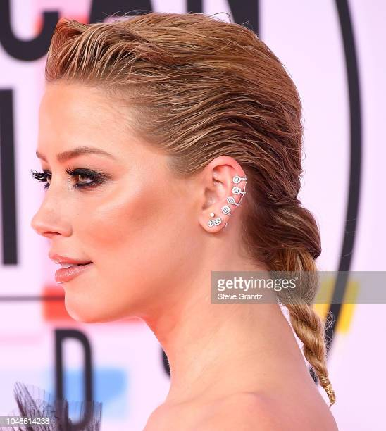 Amber Heard arrives at the 2018 American Music Awards at Microsoft Theater on October 9 2018 in Los Angeles California