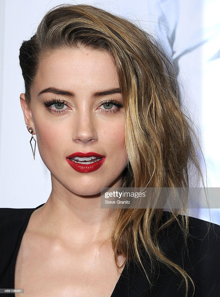 Amber Heard arrives at the '3 Days To Kill' at ArcLight Cinemas on February 12, 2014 in Hollywood, California.