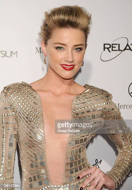 """Amber Heard arrives at The Art Of Elysium's 4th Annual Black Tie Charity Gala """"Heaven"""" at The Annenberg Building at the California Science Center on..."""