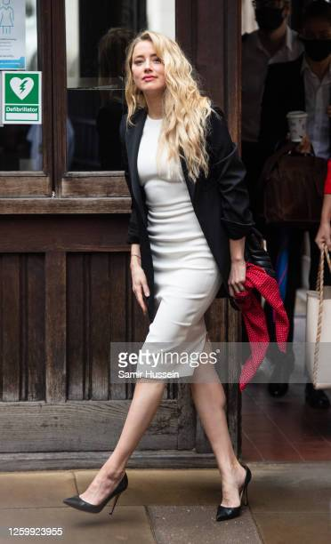 Amber Heard arrives at the Royal Courts of Justice, Strand on July 27, 2020 in London, England. Hollywood actor Johnny Depp is suing News Group...