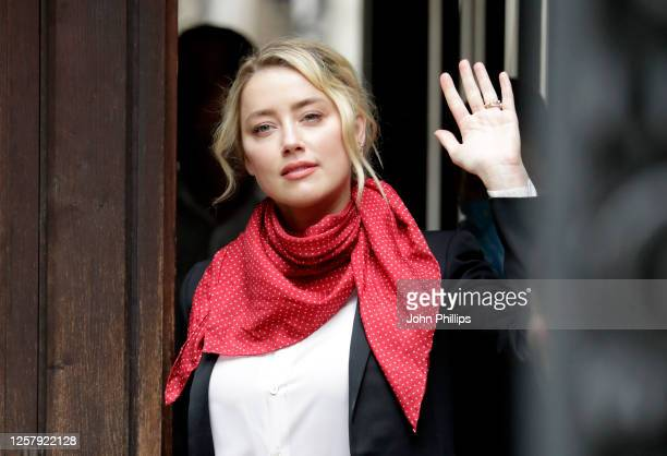 Amber Heard arrives at the Royal Courts of Justice, the Strand on July 24, 2020 in London, England. Hollywood actor Johnny Depp is suing News Group...