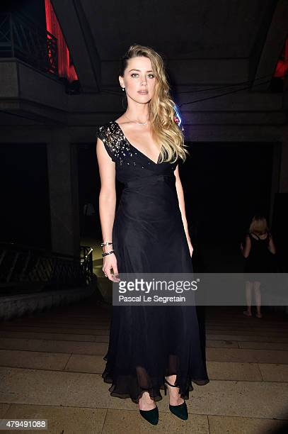 Amber Heard attends a cocktail during the Miu Miu Club launch of the first Miu Miu fragrance and croisiere 2016 collection at Palais d'Iena on July 4...