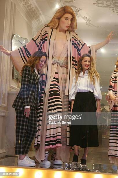 Amber Heard attends a photocall to unveil the new 'Alice In Wonderland' themed window at Temperley London on February 20 2015 in London England