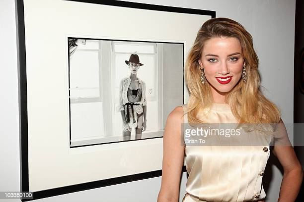 Amber Heard attends photographer Tasya Van Ree's new exhibition Untitled Project opening at the Celebrity Vault on August 11 2010 in Beverly Hills...