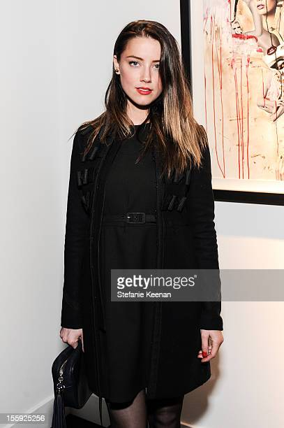 Amber Heard attends Stephen Webster Hosts Tasya Van Ree Replica Exhibition on November 8 2012 in Los Angeles California