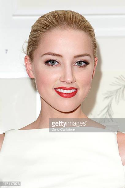 Amber Heard attends Tasya Van Ree's private viewing of Distorted Delicacies at Vs Magazine Creative Studios Paris' Space on June 22 2011 in New York...