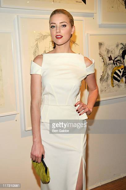 "Amber Heard attends Tasya Van Ree's private viewing of ""Distorted Delicacies"" at Vs. Magazine & Creative Studios Paris' Space on June 22, 2011 in New..."