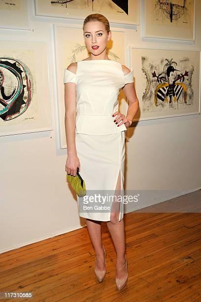 Amber Heard attends Tasya Van Ree's private viewing of Distorted Delicacies at Vs Magazine Creative Studios Paris' Space on June 22 2011 in New York...