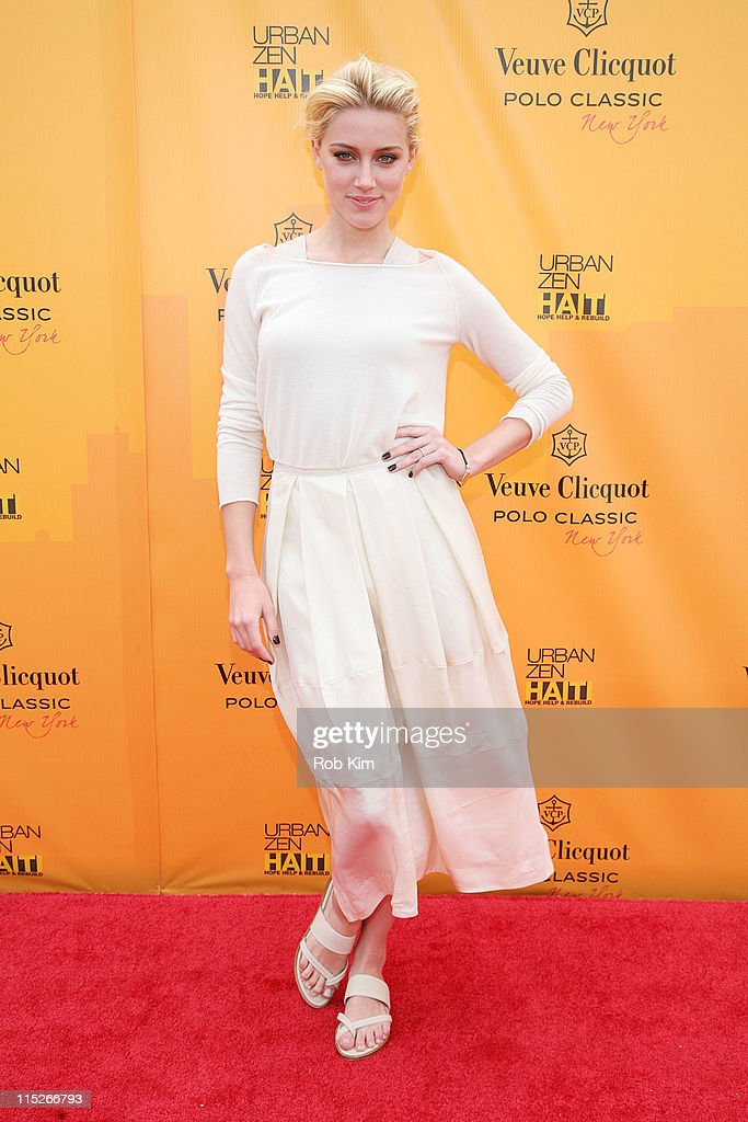 8fd4fdbc0cd027 Amber Heard attends the 2011 Veuve Clicquot Polo Classic at... News ...