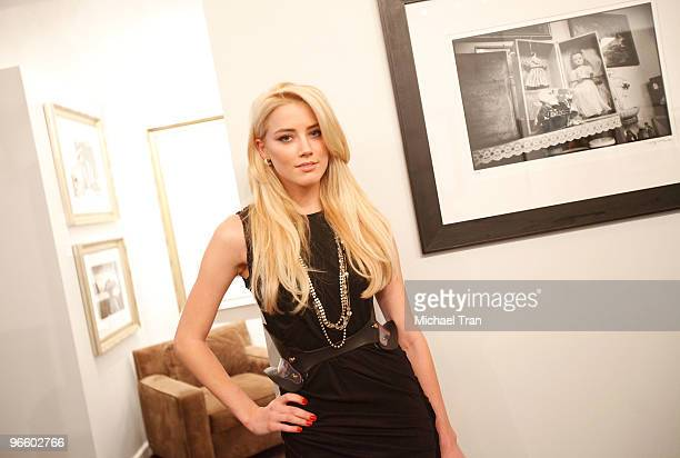 Amber Heard attends the Tasya Van Ree Charity Photo Exhibition held at The Celebrity Vault on February 11, 2010 in Beverly Hills, California.