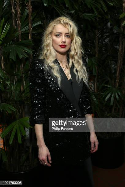 Amber Heard attends Vanity Fair and Saint Laurent Celebrate Parasite on February 07 2020 in Los Angeles California