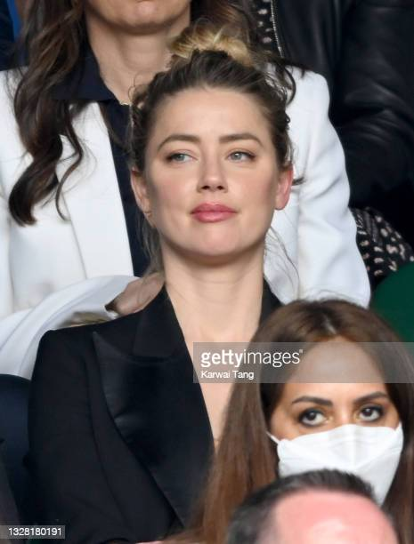 Amber Heard attends Wimbledon Championships Tennis Tournament at All England Lawn Tennis and Croquet Club on July 11, 2021 in London, England.