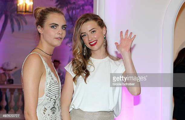 Amber Heard Cara Delevingne attend the Porsche At De Grisogono 'Fatale In Cannes' Party during the 67th Cannes Film Festival on May 20 2014 in Cannes...