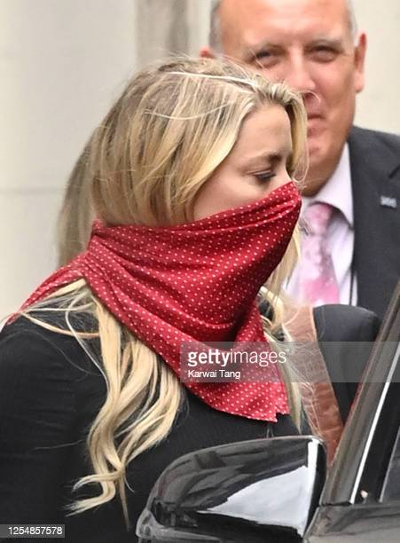 Amber Heard departs after attending day one of Johnny Depp's libel case against the Sun Newspaper at the Royal Courts of Justice Strand on July 07...