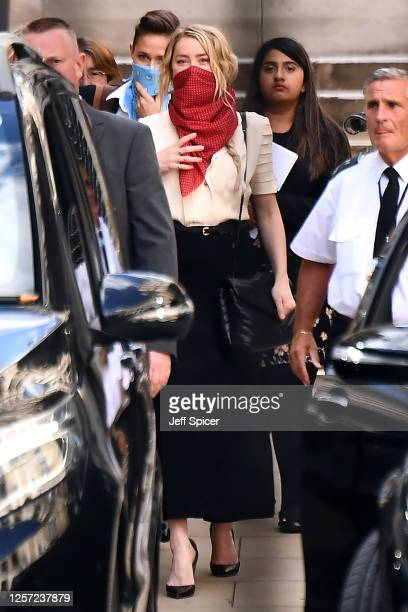 Amber Heard departs Royal Courts of Justice Strand on July 20 2020 in London England The Hollywood Actor is suing News Group Newspapers and the Sun's...