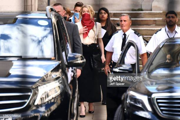 Amber Heard departs Royal Courts of Justice, Strand on July 20, 2020 in London, England. The Hollywood Actor is suing News Group Newspapers and the...