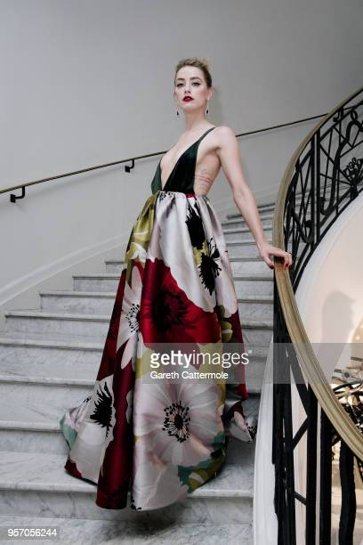 Amber Heard departs the Martinez Hotel during the 71st annual Cannes Film Festival at on May 10 2018 in Cannes France
