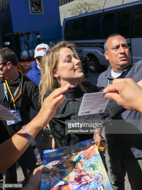 Amber Heard is seen attending DC Entertainment's Warner Bros Pictures 'Aquaman' Autograph Signing during ComicCon International 2018 at San Diego...