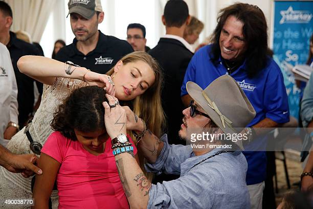Amber Heard Johnny Depp and Alice Cooper from The Hollywood Vampires attend the Starkey Hearing Foundation event to support and benefit people in...