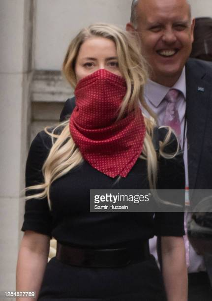Amber Heard leaves the Royal Courts of Justice Strand on July 07 2020 in London England Johnny Depp is taking News Group Newspapers publishers of The...