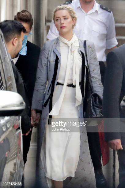 Amber Heard leaves the Royal Courts of Justice, Strand on July 21, 2020 in London, England. The Hollywood Actor is suing News Group Newspapers and...