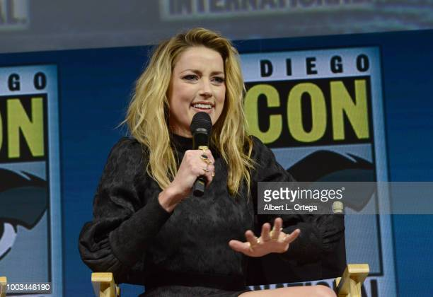 Amber Heard speaks onstage at the Warner Bros 'Aquaman' theatrical panel during ComicCon International 2018 at San Diego Convention Center on July 21...
