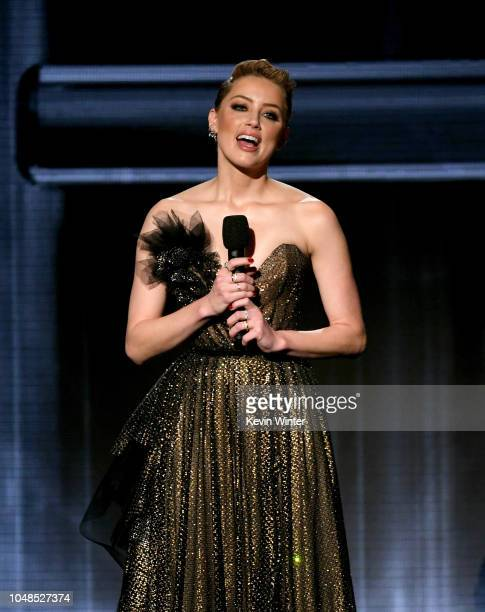 Amber Heard speaks onstage during the 2018 American Music Awards at Microsoft Theater on October 9 2018 in Los Angeles California