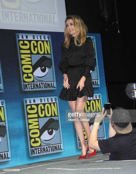 Amber Heard walks onstage at the Warner Bros 'Aquaman' theatrical panel during ComicCon International 2018 at San Diego Convention Center on July 21...