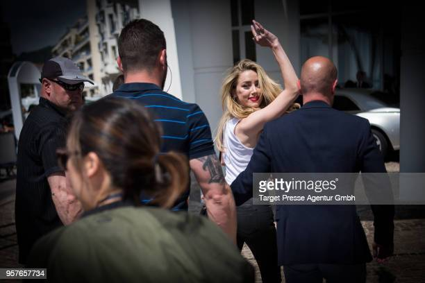Amber Heard waves on her way to Hotel Martinez during the 71st annual Cannes Film Festival at on May 12 2018 in Cannes France