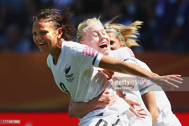 Amber Hearn of New Zealand celebrates her team's first goal with team mate Betsy Hassett during the FIFA Women's World Cup 2011 match between Japan...