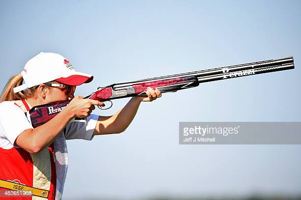 Amber Hill of England competes in the skeet qualification at Barry Buddon Shooting Centre during day two of the Glasgow 2014 Commonwealth Games on...