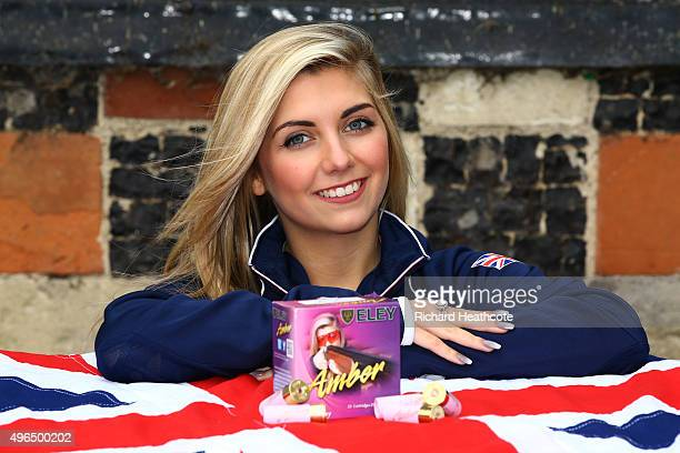 Amber Hill poses with her personalised shotgun cartridges during the Team GB announcement of the Shooting Team for Rio 2016 Olympic Games at Bisham...