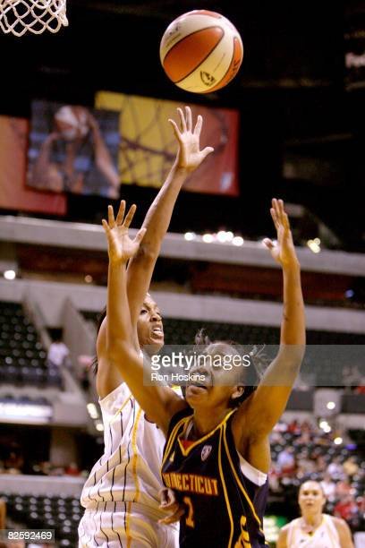 Amber Holt of the Connecticut Sun battles Tammy SuttonBrown of the Indiana Fever at Conseco Fieldhouse on August 28 2008 in Indianapolis Indiana The...